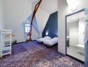 een slaapkamer in het Akouticum
