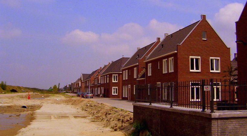Grondprijzen woningbouw gemeenten stijgen niet mee met woningprijzen